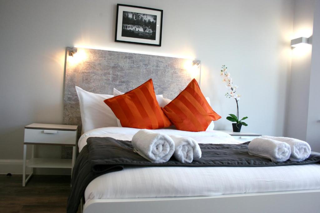 A bed or beds in a room at Westciti Caroco Aparthotel