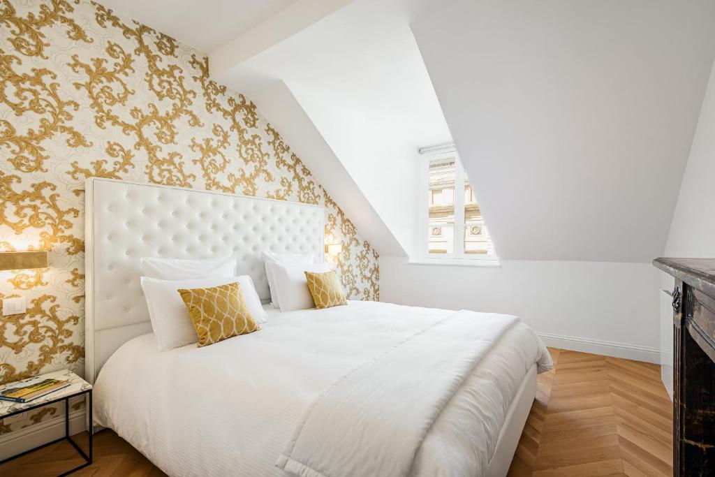 Cama o camas de una habitación en Les Demoiselles à Versailles - Au Pied du Château