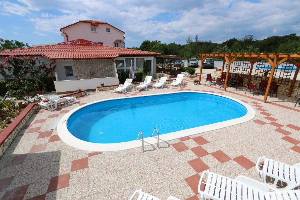 The swimming pool at or close to Pansion Comfort Sidro
