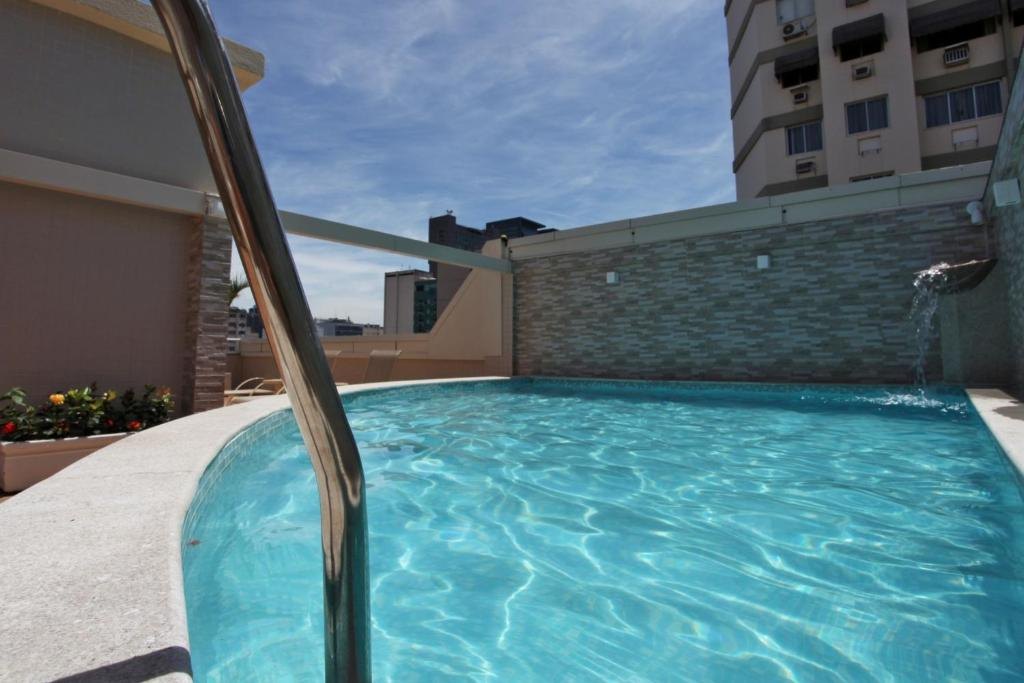 The swimming pool at or near Fluminense Hotel
