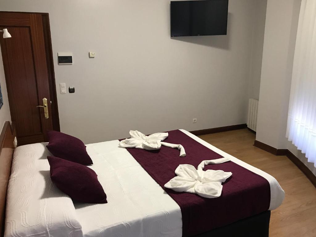 Ein Bett oder Betten in einem Zimmer der Unterkunft Pensión La Salve