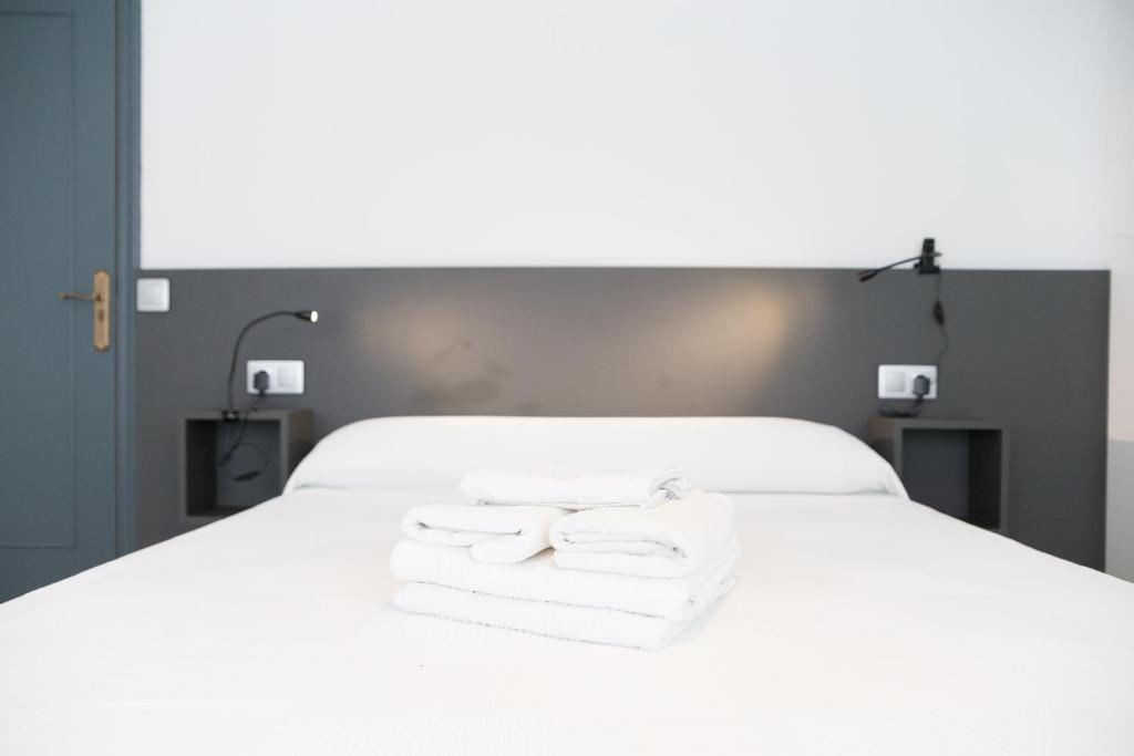 A bed or beds in a room at O Tobo do Lobo