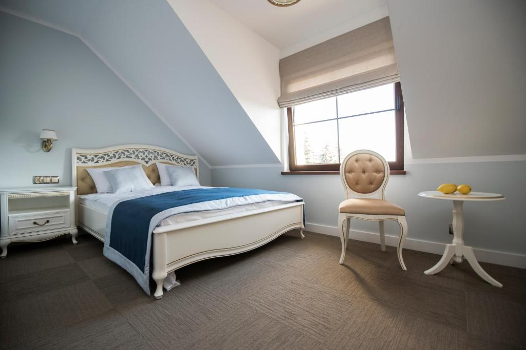 A bed or beds in a room at Spalnia B&B