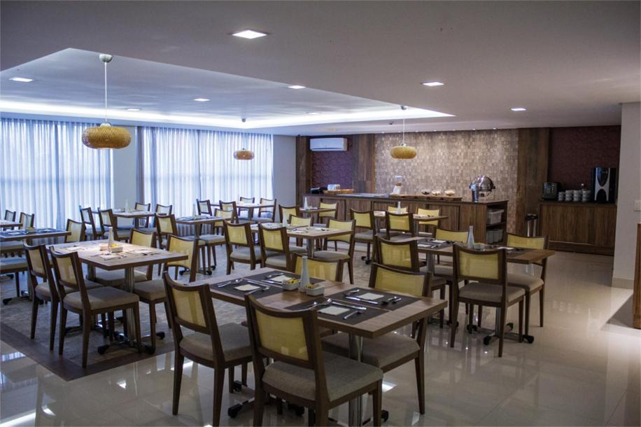 A restaurant or other place to eat at Solaris Hotel