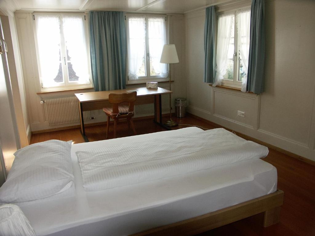Ein Bett oder Betten in einem Zimmer der Unterkunft Landgasthof Bären
