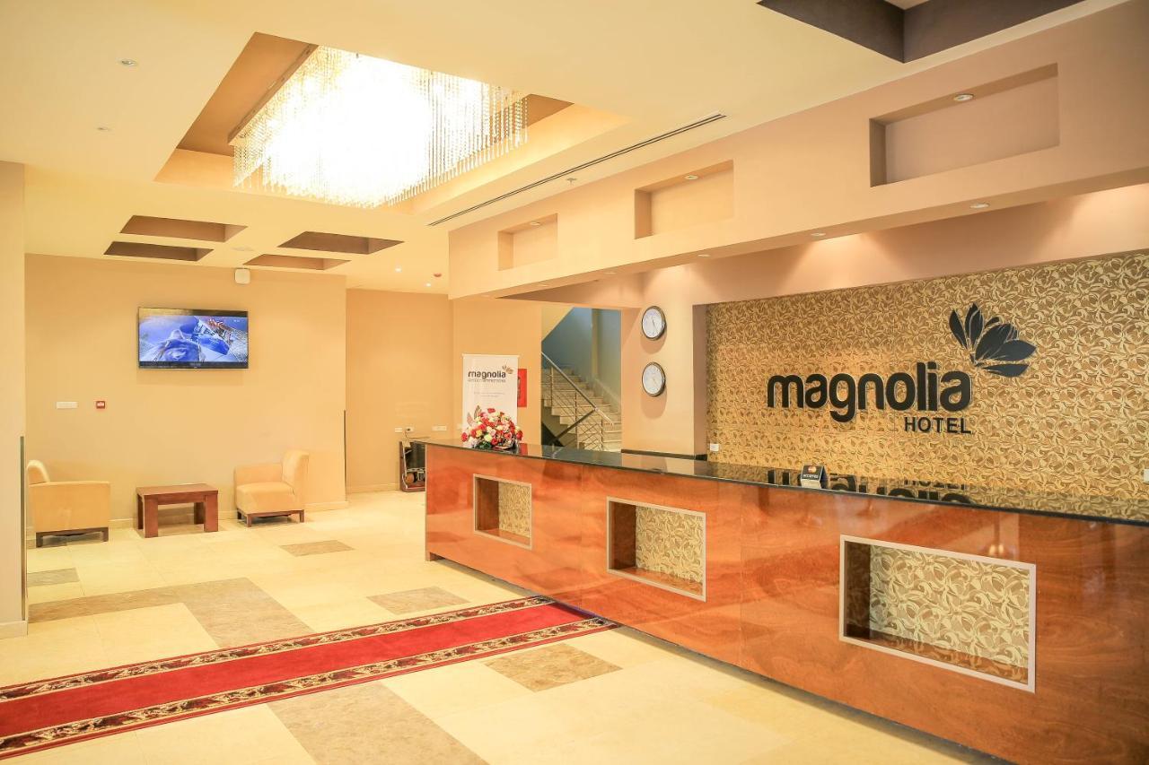 Отель  Отель  Magnolia Hotel & Conference Center
