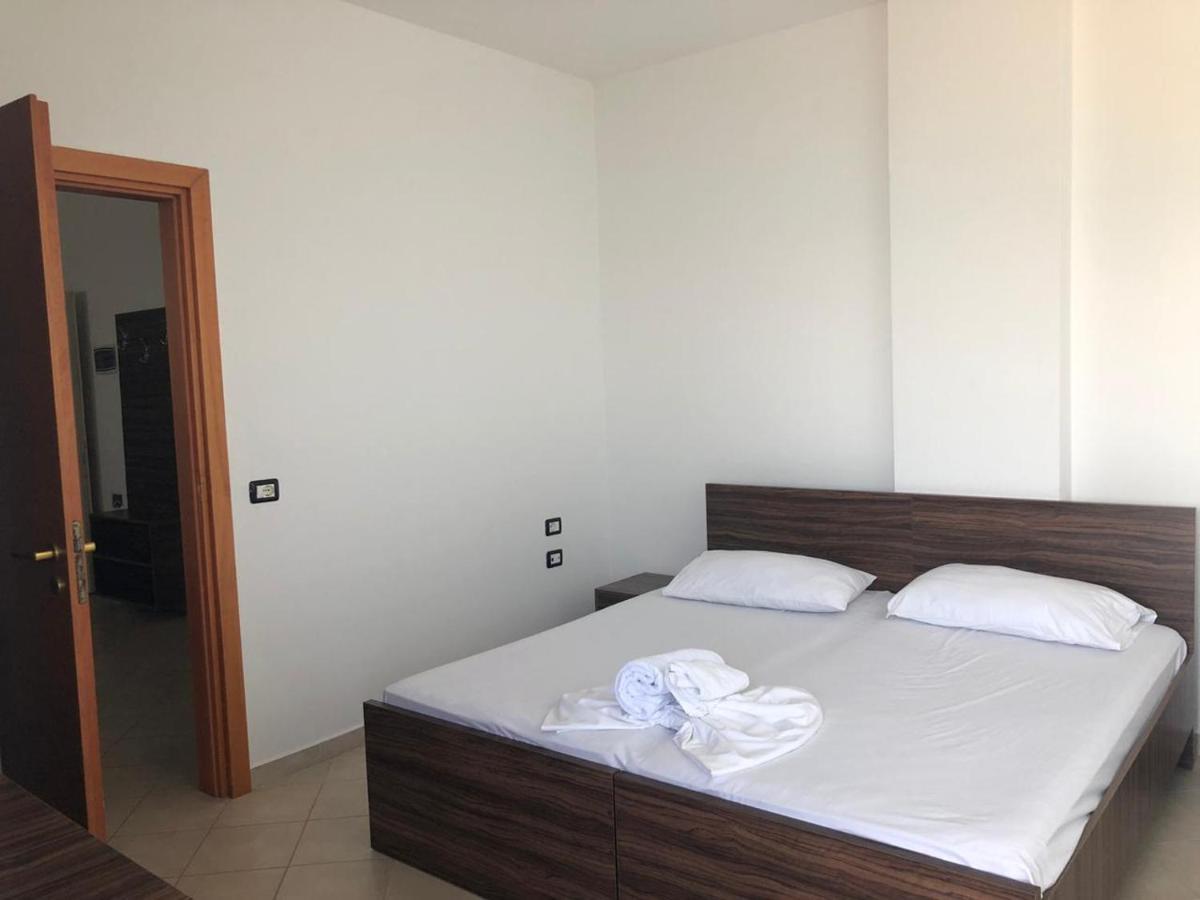 Кровать или кровати в номере Sinella Holiday