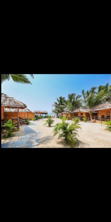 Отель  Blue Corner Beach Huts & Restaurant