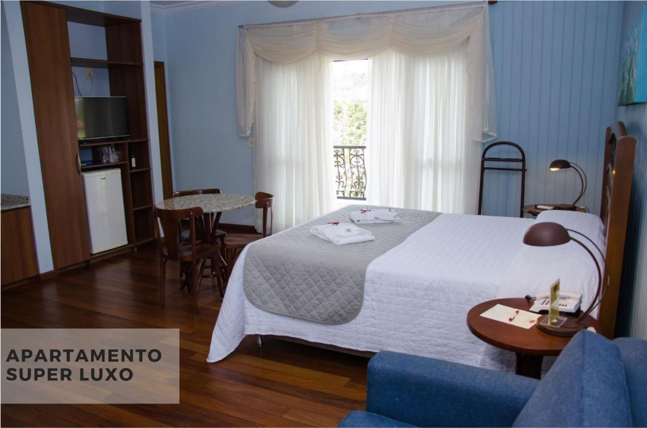 Foto Booking - hotel Villa Michelon - quarto