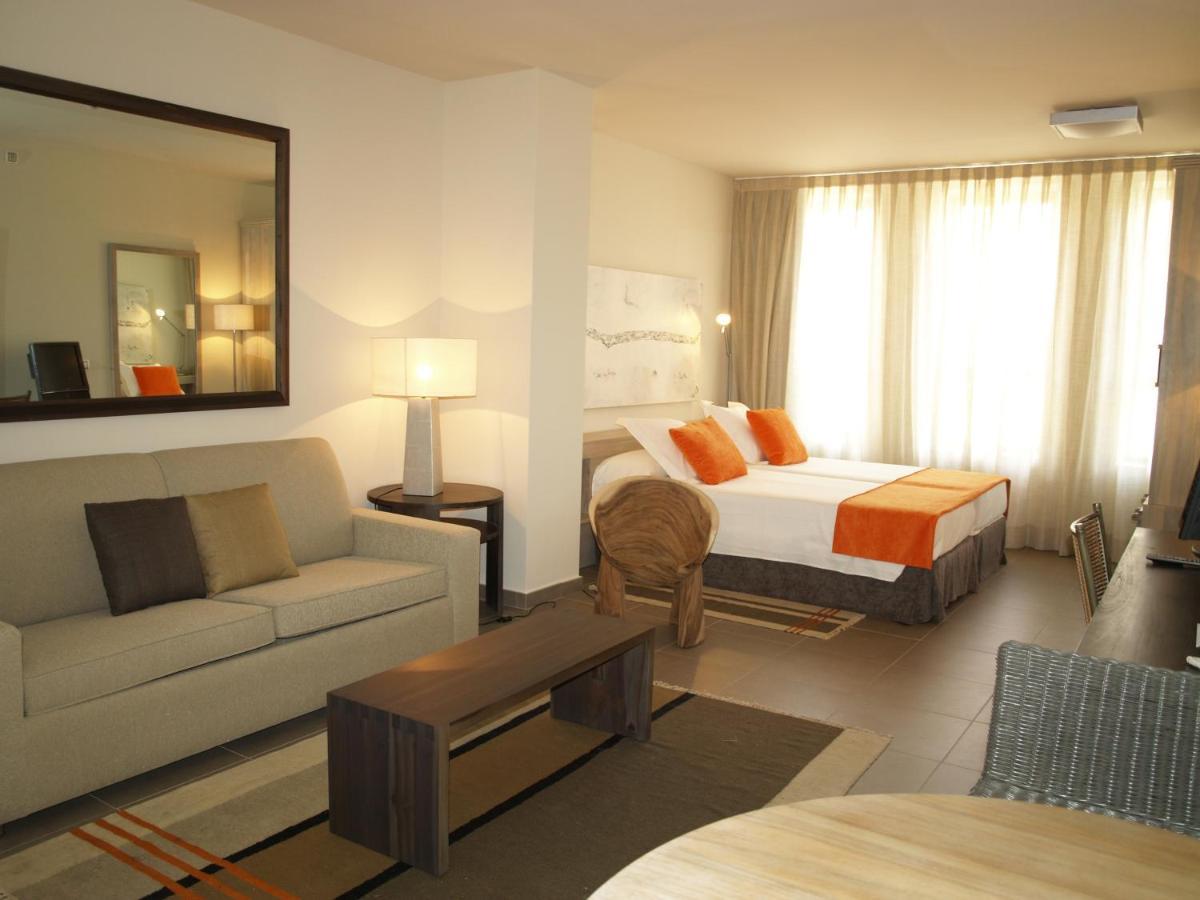 Отель  Eco Alcalá Suites
