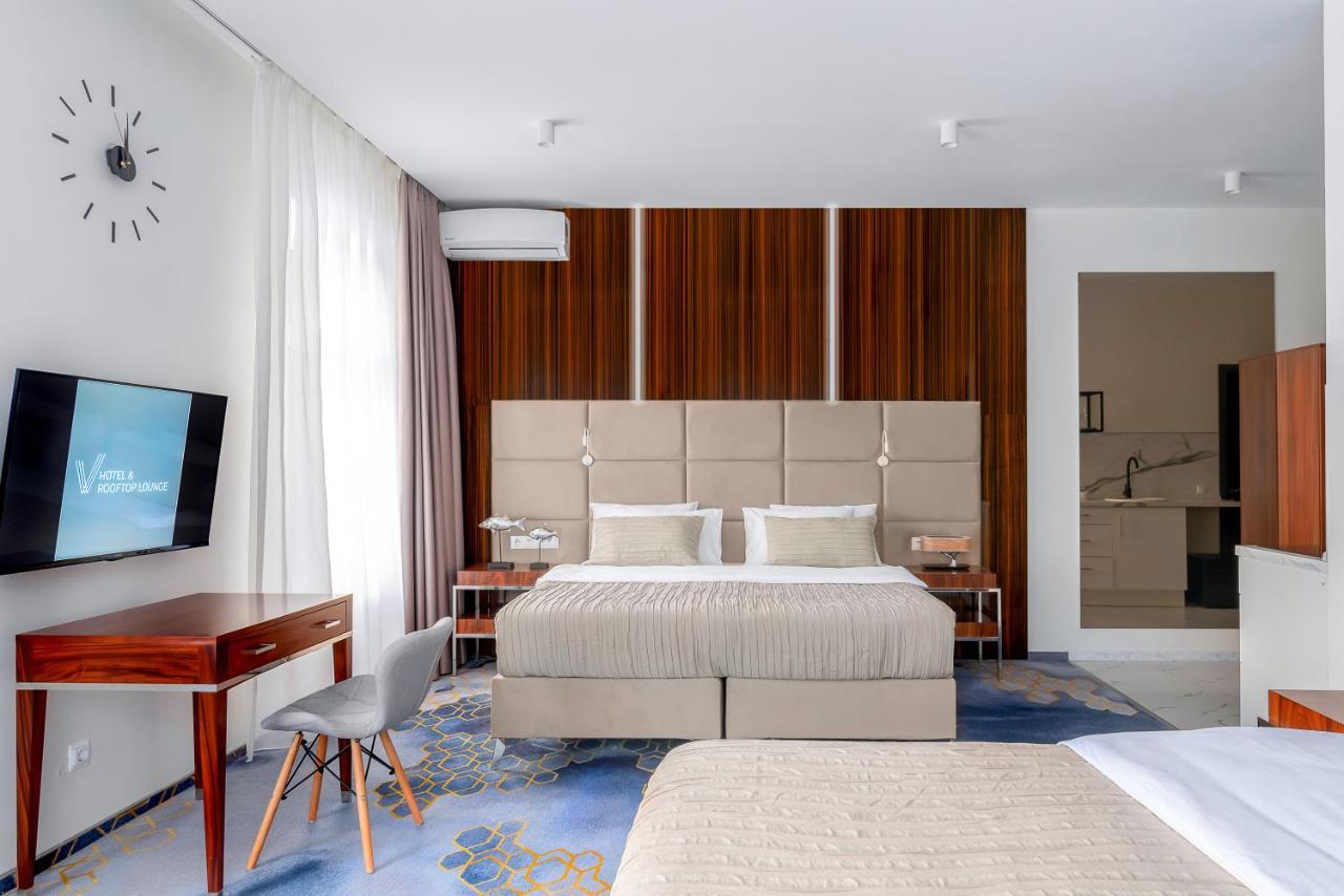 Отель  V Hotel&Rooftop Lounge