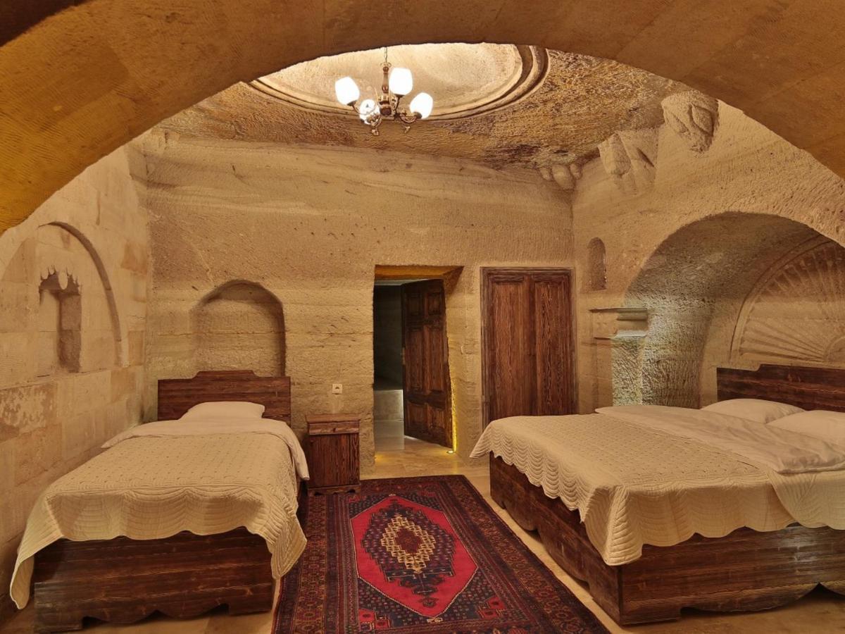 Отель  Family Cave Suite Hotel