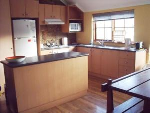 A kitchen or kitchenette at Woodvale at Cooma