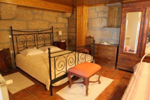 A bed or beds in a room at Casa Das Senhoras