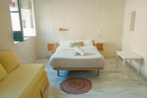 A bed or beds in a room at The Nomad Hostel&Pension