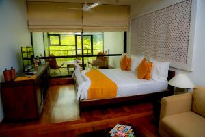 A bed or beds in a room at Rockwell Colombo