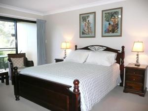 A bed or beds in a room at Yarrandabbi Dreaming Boutique B&B