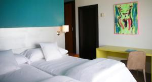 A bed or beds in a room at Hotel Ritual Torremolinos- Adults Only