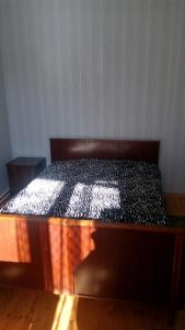 A bed or beds in a room at Guest House Rusudan