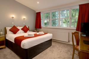 A bed or beds in a room at Best Western Andover