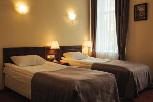 Кровать или кровати в номере Акапелла на площади Восстания