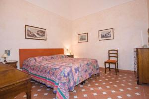 A bed or beds in a room at Appartamento Matteotti