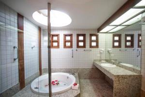 Um banheiro em Bupitanga Hotel