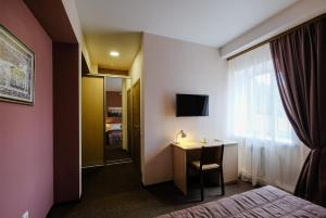 A television and/or entertainment center at Hotel Galereya