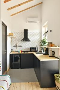 A kitchen or kitchenette at New apartment with amazing views in Old Tbilisi