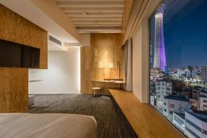 A television and/or entertainment center at ONE@Tokyo