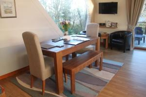 A seating area at Invergloy Riverside Lodges