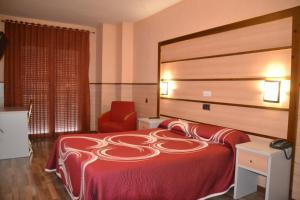 Cama o camas de una habitación en Hotel Pio XII Jumilla