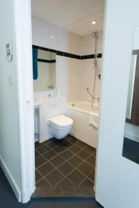 Een badkamer bij Hotel Park Plantage