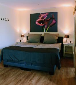 Ein Bett oder Betten in einem Zimmer der Unterkunft Pension am Birkensee