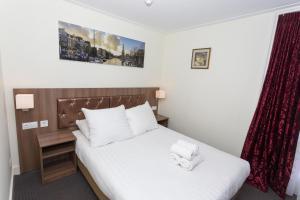Een bed of bedden in een kamer bij Hotel Park Plantage