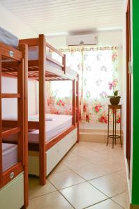 A bunk bed or bunk beds in a room at Beira Mar Hostel & Suítes