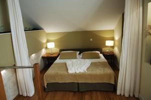 A bed or beds in a room at Villa Noa