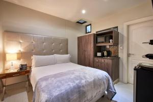 A bed or beds in a room at Dynasty Forest Sandown Hotel & Conference Center
