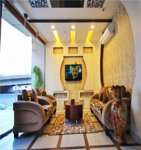 A seating area at Arwaa Massa Aparthotel