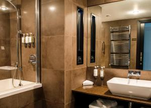 A bathroom at The Vincent Hotel