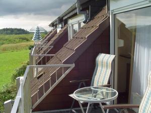 Ein Balkon oder eine Terrasse in der Unterkunft Apartments Boddenhof Stedar