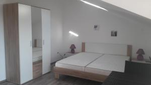 A bed or beds in a room at Apartments Jovic