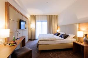 Ein Bett oder Betten in einem Zimmer der Unterkunft Böswarth Seminarhotel Lengbachhof