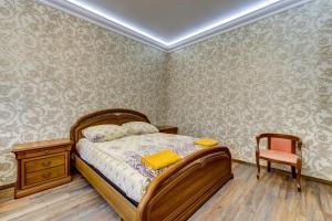 Кровать или кровати в номере STN Deluxe on Karavannaya 26