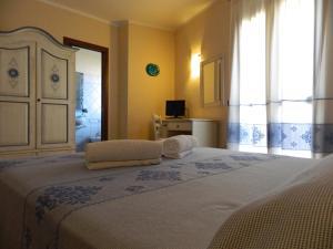 A bed or beds in a room at Real B&B Primo Sole