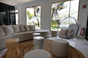 Een zitgedeelte bij Hotel Rei Del Mediterrani Palace