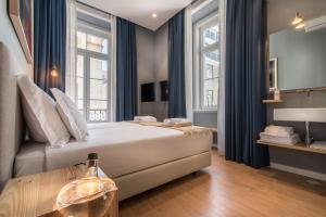 Tempat tidur dalam kamar di Esqina Urban Lodge