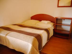 Łóżko lub łóżka w pokoju w obiekcie Bursztyn