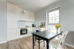 Kuchnia lub aneks kuchenny w obiekcie Emarald Apartment
