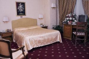 A bed or beds in a room at Hotel Bled